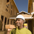 Male construction worker smiling at construction site — Stock Photo #23253282