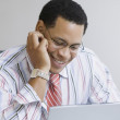 African American businessman with laptop - Stock Photo