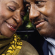 Close up of senior African couple touching foreheads — Stock Photo