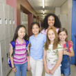 Young girls in school hallway - Stockfoto