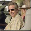 Middle-aged couple sitting in convertible — Foto de Stock