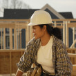 Asian female construction worker at construction site — Stock Photo