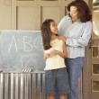 Hispanic female teacher with female student - Stockfoto