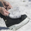 Stock Photo: Close up of mlacing ice skate