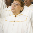 Senior African women singing in a choir — Stock Photo
