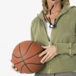 Studio shot of woman with whistle and basketball — Stock Photo