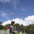 Asian father and son flying a kite  — Stock Photo