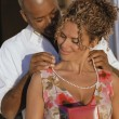 African American man putting necklace on African American woman — Stock Photo #23254442