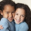 Stock Photo: Close up of two young girls hugging