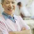 Senior Asian female dental assistant smiling — Stock Photo