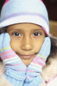 Close up of girl wearing mittens and hat — Stock Photo