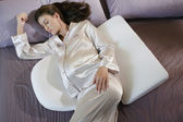Pregnant woman sleeping with back and stomach pillows — Stock Photo