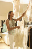 African woman shopping at clothing store — Stock Photo
