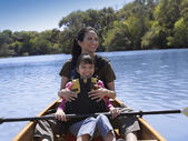 Hispanic mother and daughter in canoe — Stock Photo