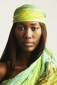 African woman with scarf around head — Stock Photo