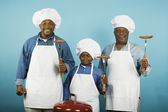 Multi-generational African male family members with barbeque grill — Foto Stock