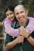 Hispanic grandfather and granddaughter hugging outdoors — Stock Photo