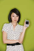 Studio shot of Asian woman holding electronic organizer — Stock Photo