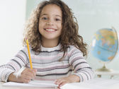 Young girl in classroom smiling — Stock Photo