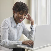 African businesswoman using laptop — Foto Stock