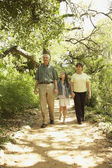 Hispanic grandparents and granddaughter outdoors — Foto Stock