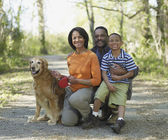 African family with dog on nature trail — 图库照片