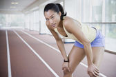 Female runner on indoor track — Stock Photo