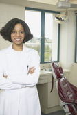 African female dentist smiling — Stock Photo