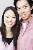 Young Asian couple smiling — Stock Photo