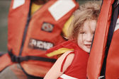 Young girl and parent wearing life-jackets — Stock Photo