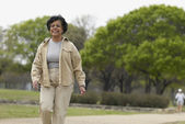 Senior African woman walking in park — Stock Photo