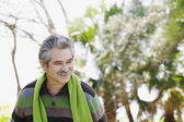 Middle-aged man walking outdoors — Stock Photo