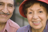 Close up of senior Hispanic couple smiling outdoors — Stock Photo