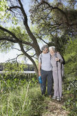 Senior Hispanic couple hiking — Stock Photo