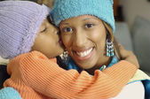 African American girl kissing mother — Stock Photo