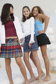 Low angle view of three teenaged girls — Foto de Stock