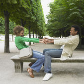 African couple smiling at each other in park — Stock Photo