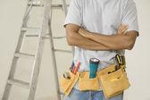 Close up of man wearing tool belt — Stock Photo