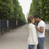 African couple touching foreheads in park — Stock Photo