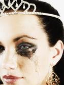 Woman wearing tiara and crying — Stock Photo
