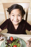 Young Asian girl eating salad — Stock Photo