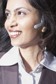 Close up of Indian businesswoman using headset — Stok fotoğraf