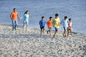 Hispanic family walking on beach — Stock Photo