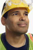 Close up of Hispanic man wearing hard hat and safety goggles — Stock Photo