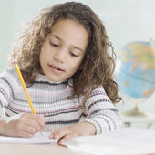 Young girl working in classroom — Stock Photo