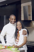 African American couple smiling in kitchen — Stock Photo