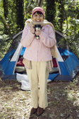 Senior woman with thermos next to tent — Stock Photo