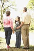 Hispanic girl standing with family outdoors — Stock Photo