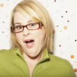 Surprised young woman wearing eyeglasses — Stock Photo