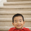 Portrait of Asiboy on stairs — Stock Photo #23270524